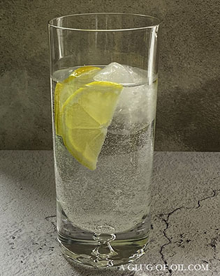 Large round ice cubes in a tall glass