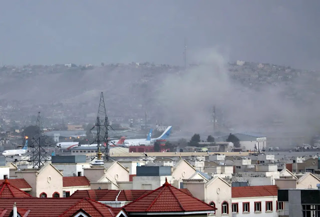 Smoke rises from the Hamid Karzai airport area, where large-scale evacuations are taking place after the Taliban took over the capital Kabul: AP