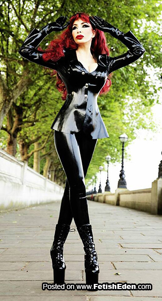 Hot redhead outdoors wears black latex leggings with black latex top and black latex gloves with black PVC boots
