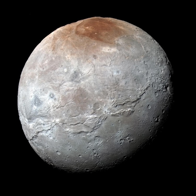 Pluto 'paints' its largest moon Charon red