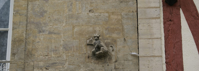 Stine carving on a building  in Bayeux, Normandy