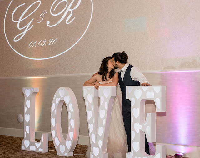 giant love letter with newlyweds