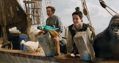 "Harry Collett and Robert Downey Jr. are on a boat in a movie still for ""Dolittle."""