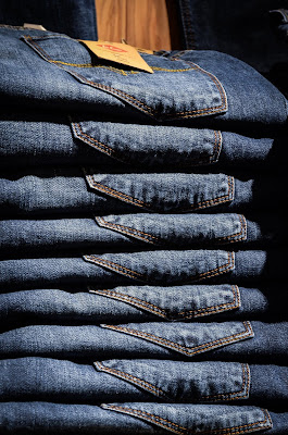 Stack of blue jeans from the Loja Jean Fair
