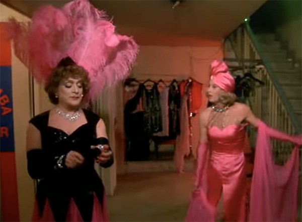 Vinicio Diamanti and Mario Amendola femulate in a 1984 Italian film titled Delitto al Blue Gay also known as Cop in Drag. This film is jam-packed with femulators.