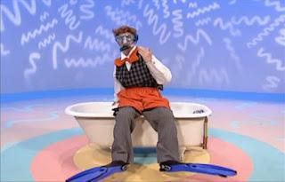 Mr Noodle dresses in scuba gear. Sesame Street Elmo's World Bath Time The Noodle Family