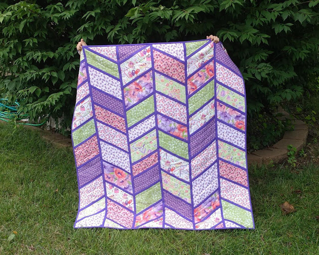 Split Arrows quilt - a chevron baby quilt made with pink and purple fabrics