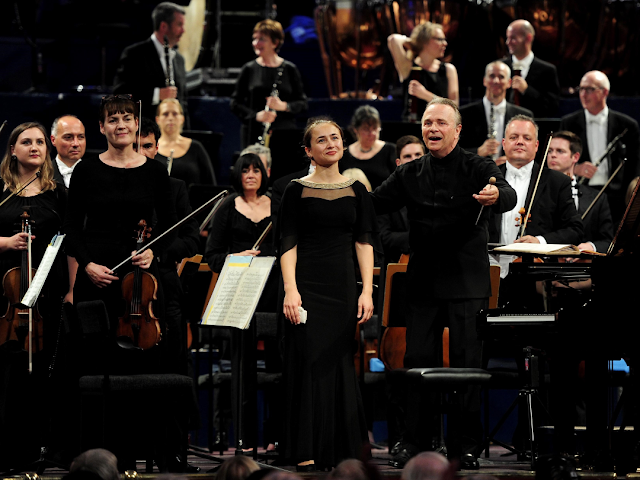 Anna Tsybuleva with Sir Mark Elder and the Halle after her performance of Brahms' Piano Concerto No. 2 at the Leeds International Piano Competition in 2015 (Photo Alex Whitehead/SWpix.com)