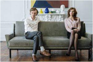 Man and woman sitting on a couch thinking about dividing property in a divorce