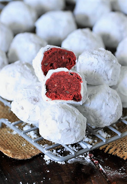 Red Velvet Snowball Cookies on Cooling Rack Image
