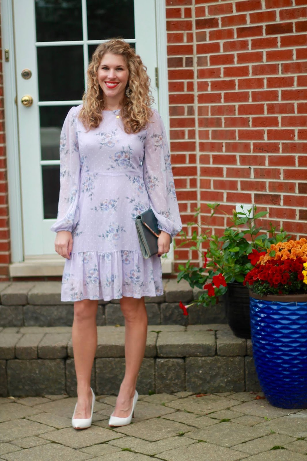 lavender floral dress, white heels, grey envelope clutch