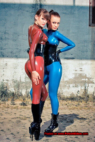 Alexandra Potter and Valerie Tramell wearing latex catsuits
