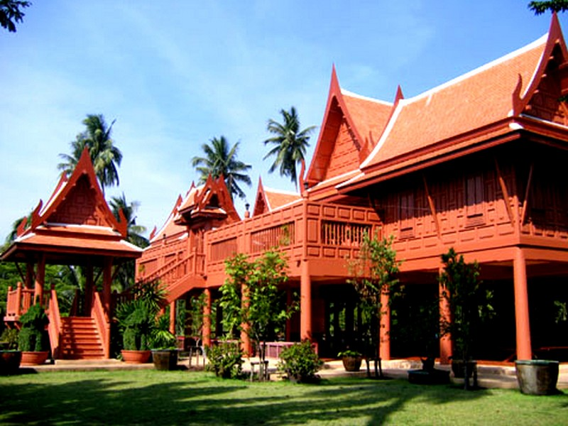 thai houses have steep roofs arching upwards towards the sky both the ...