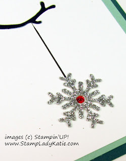 Close up of the Silver Glimmer Snowflake with Red Rhinestone by StampLadyKatie