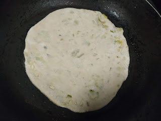 Cooking aloo paratha in a non stick pan