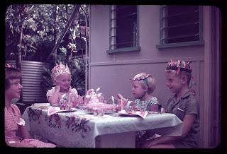 March 1963 my birthday party outside the kitchen windows