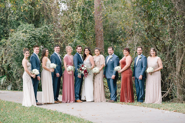 bridal party in grey and shades of red pink and cream