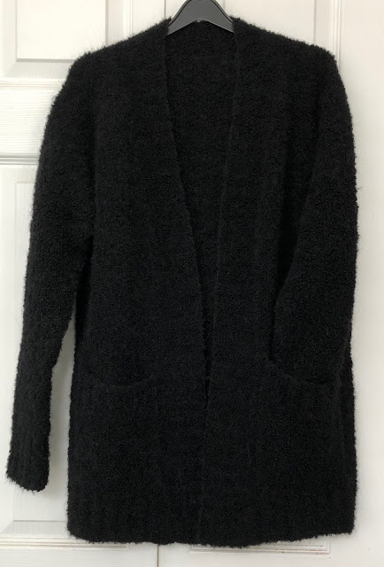 Hand-knitted long cardigan with black boucle yarn