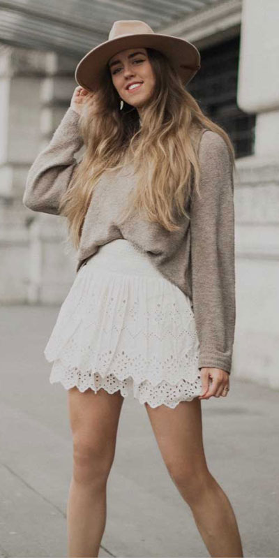 Fall in love this winter season with these cozy sweater outfits. Winter Fashion via higiggle.com | sweater with skirt | #sweater #skirt #fashion #knit