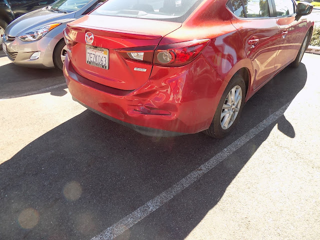 """Mazda 3 before repairs & tri-stage """"Soul Red"""" paint at Almost Everything Auto Body."""