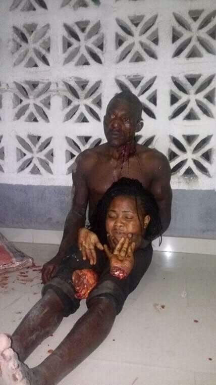 Very graphic: Man poses with head of pretty lady he beheaded in Lagos