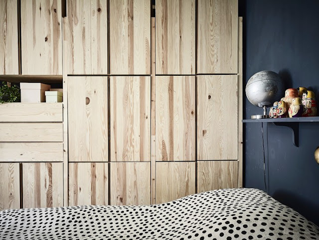 Bedroom With Dark Walls and Natural Wood 2