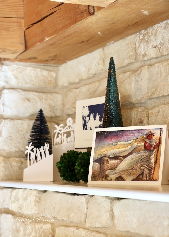 Blue O Holy Night shelf decor has exquisite Christmas cards including a shepherd boy with his flock of sheep and wind-blown garments under a night sky