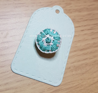 Turquoise thread button by Gina Barrett