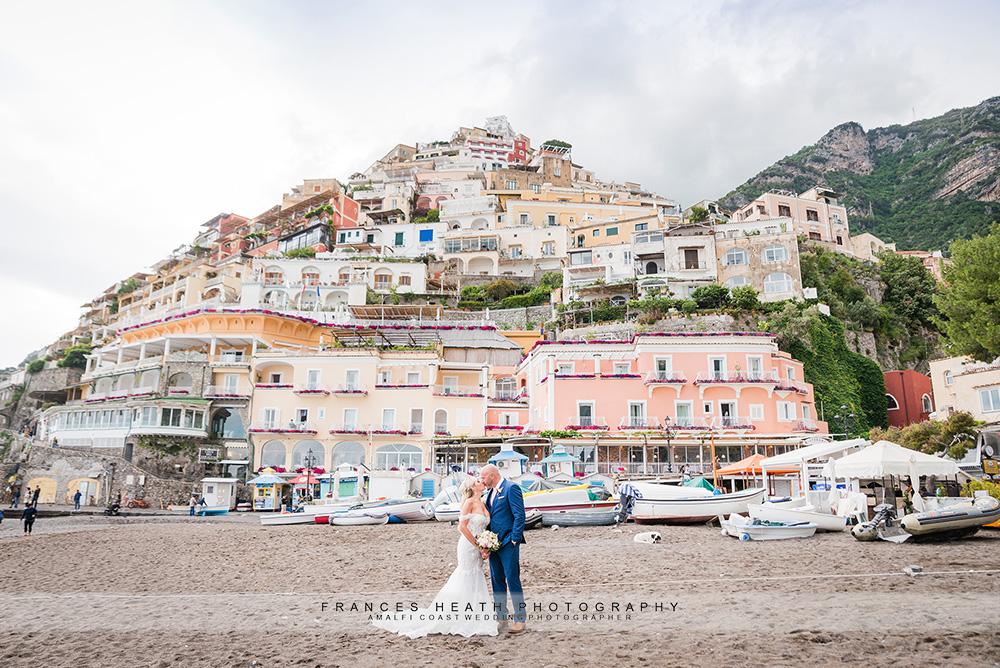 Bride and groom on Positano beach