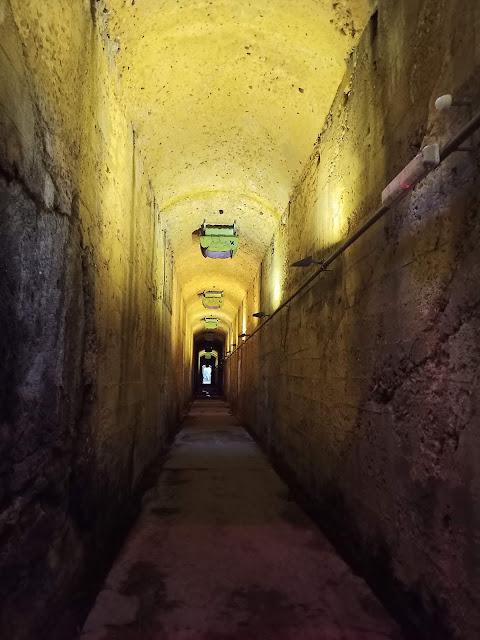 Inside dimly lit long tunnel under Coal Loader site
