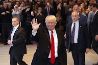 Trump waves to crowd as he leaves New York Times Tuesday. (Credit: AP/Mark Lennihan) Click to Enlarge.