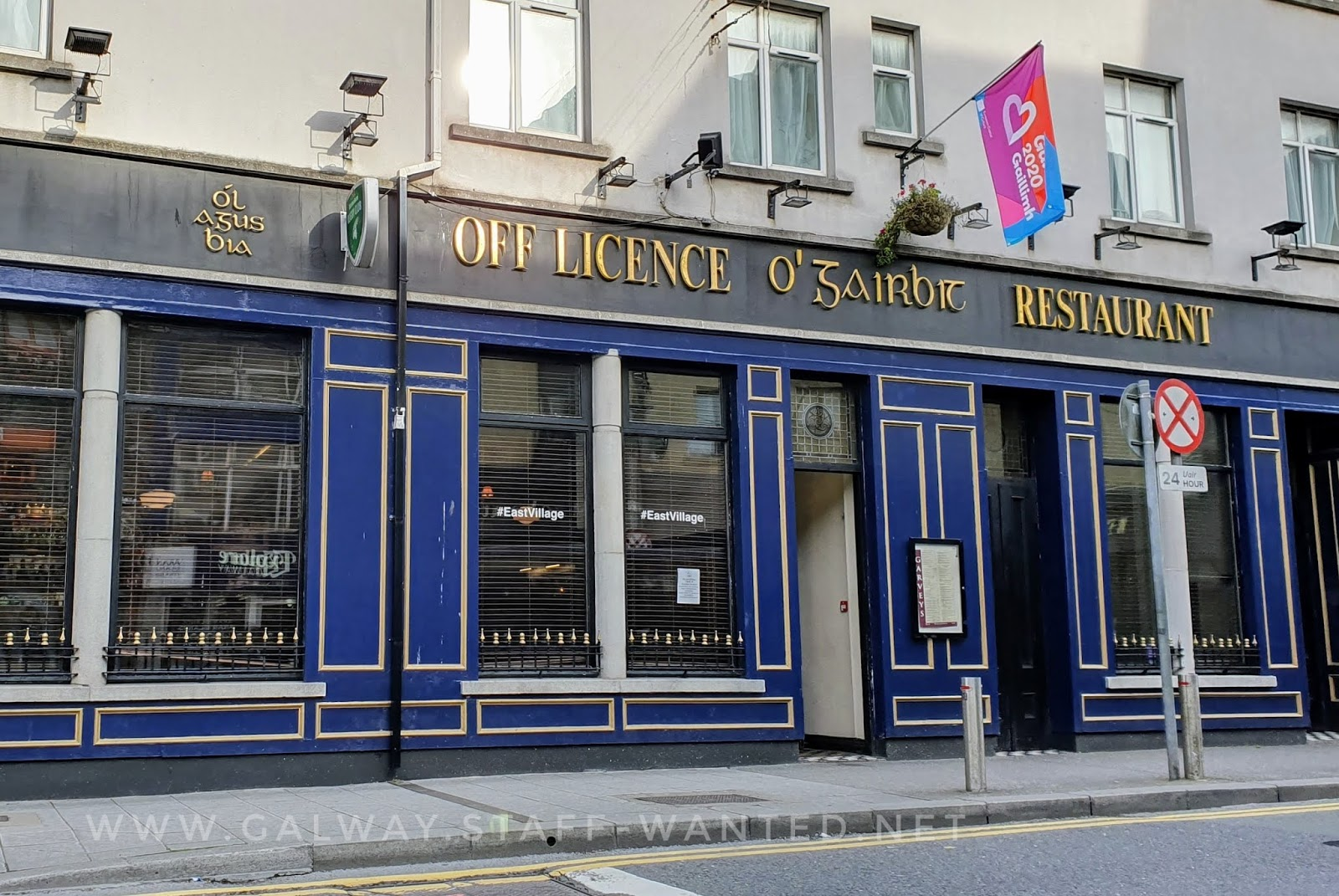 city centre bar displaying purple, blue and orange Galway 2020 flag