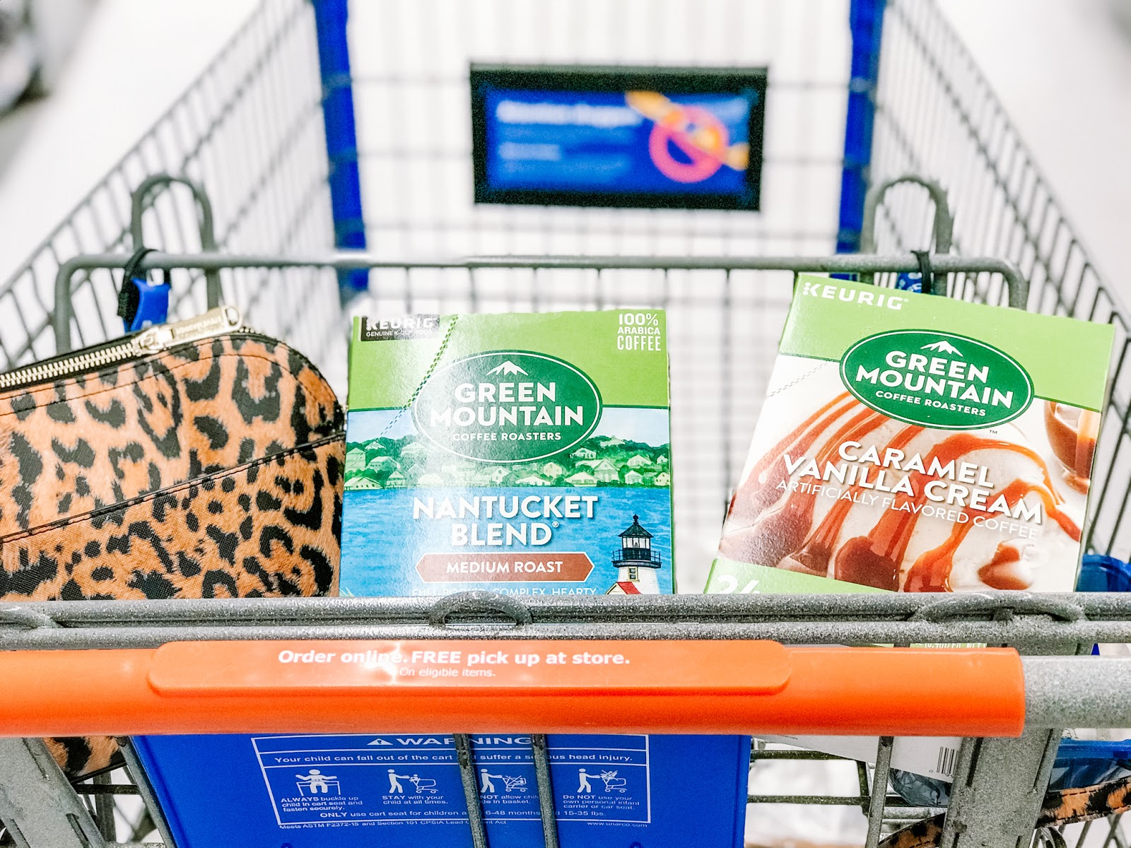 a Walmart shopping cart with green mountain coffee k cups