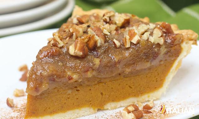 pecan pumpkin pie on a white plate