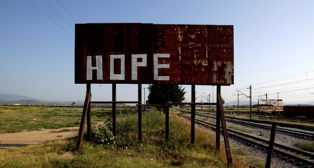 A rusty sign stands next to railway tracks where the refugees and migrants makeshift camp was at the Greek-Macedonian border near the village of Idomeni, Greece, August 10, 2016. REUTERS/Alexandros Avramidis