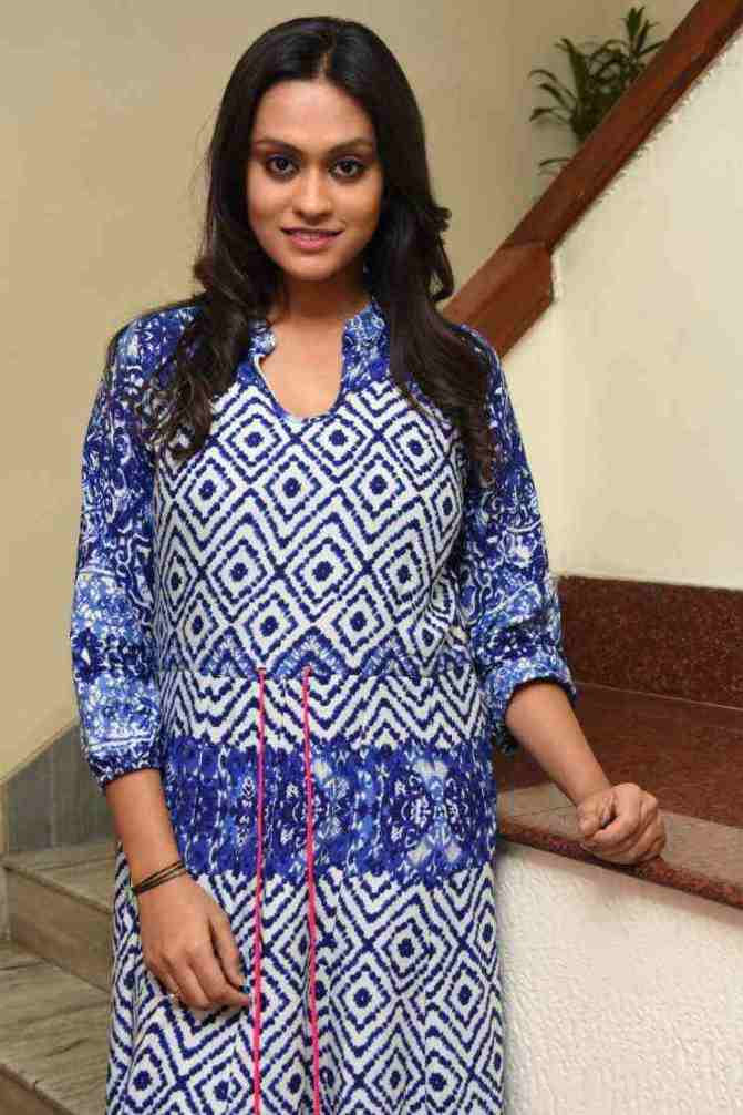 Telugu TV Anchor Geetha Bhagath Stills In Blue Dress