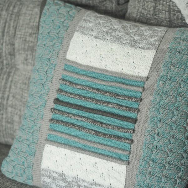 blue and grey cushion on grey sofa