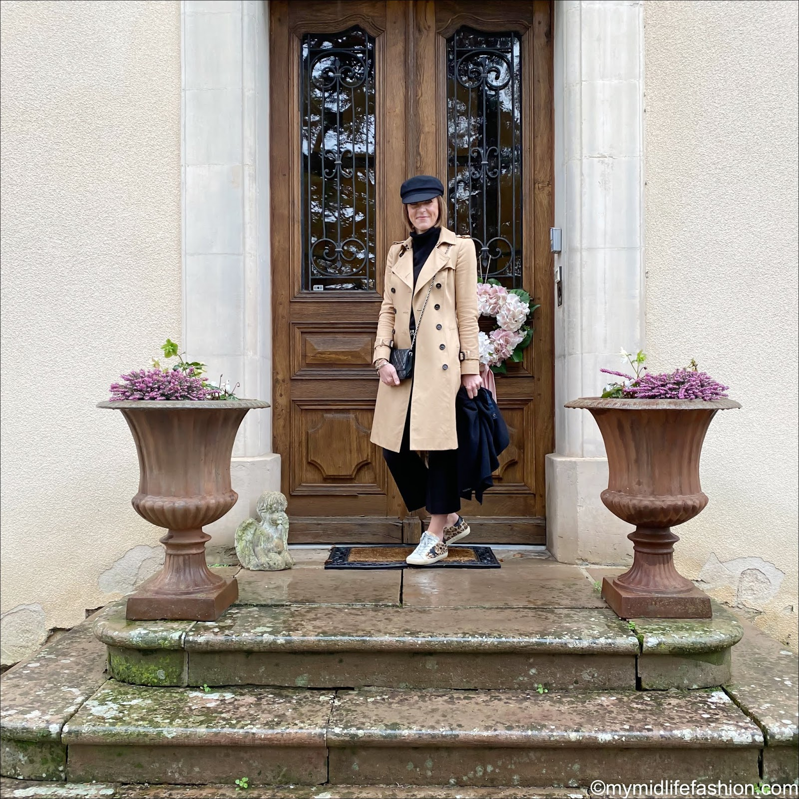 my midlife fashion, Isabel Marant Evie cotton baker boy hat, Burberry trench, Marks and Spencer pure cashmere roll neck jumper, Chanel wallet on a chain, Zara cashmere oversized scarf, j crew kick flare trousers, golden goose superstar low top leather leopard print trainers