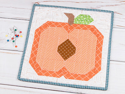 http://www.fatquartershop.com/summer-peach-mini-quilt-downloadable-pdf-quilt-pattern
