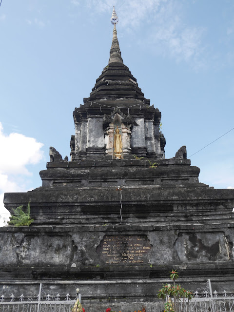 an ancient stone Buddhist monument holds a holy relic