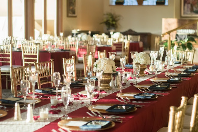 gold and burgundy reception tables