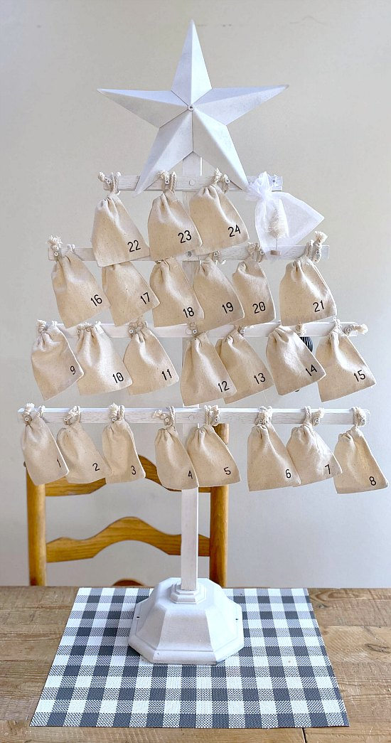 Standing white Christmas tree with muslin bags