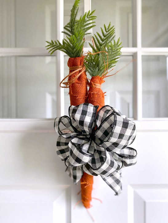 Gather a bunch of burlap carrots and a buffalo checked bow for a front door wreath