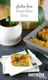 Easy Gluten Free Fried Rice Slice Recipe - slice of baked fried rice on white rectangular plate in front of grey baking dish and plant in white pot