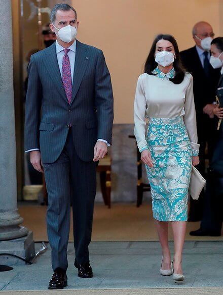 Queen Letizia wore a bespoke a mint blue embroidered pencil skirt and an ecru satin blouse from Juan Duyos. Magrit Cara clutch and Magrit pumps