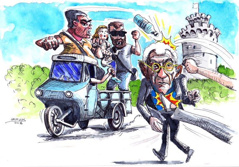 Τα τρίκυκλα των Γκοτζαμάνηδων είναι το θέμα της γελοιογραφίας του IaTriDis  με αφορμή την επίθεση στον Γιάννη Μπουτάρη παραμονές των 55 χρόνων από την δολοφονία Λαμπράκη.