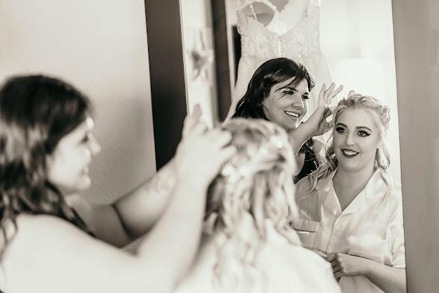 Hair stylist doing Bride's hair Getting ready