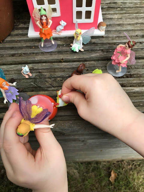 Child playing with the animals and fairies