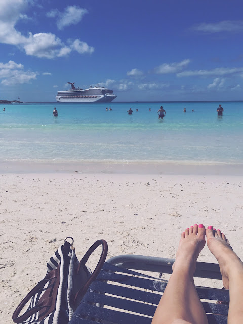 View of Carnival Glory cruise ship from beach on Half Moon Cay, Bahamas
