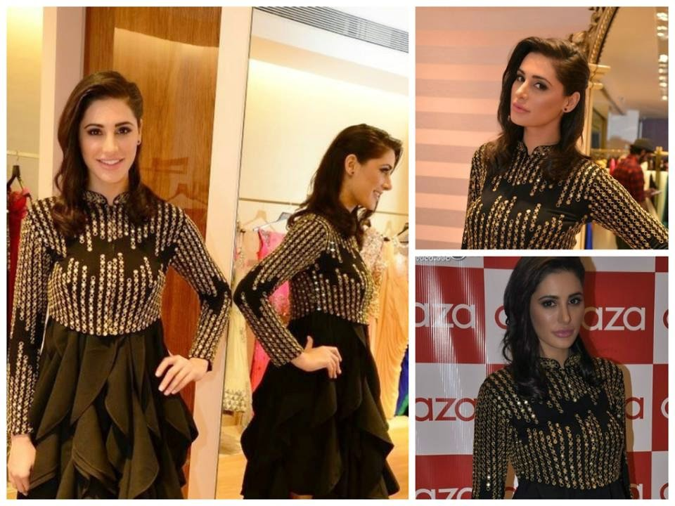 The stunning Nargis Fakhri attended the Aza store launch in Mumbai. The actress looked gorgeous in a Varun Bahl and Malini Ramani creation.